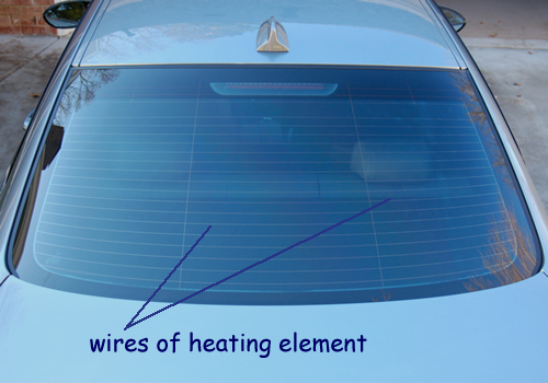a cyberphysics page the heating element is part of an electrical circuit connected to the battery of the car
